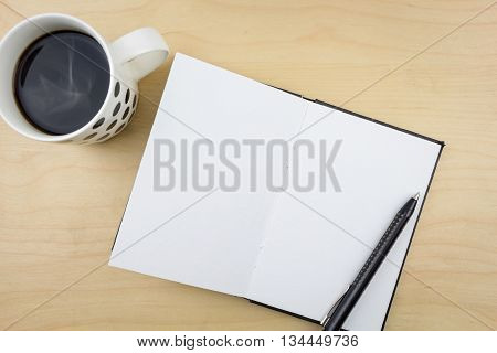 Open Notebook With Black Pen And A Cup Of Coffee, On Wooden Surface.