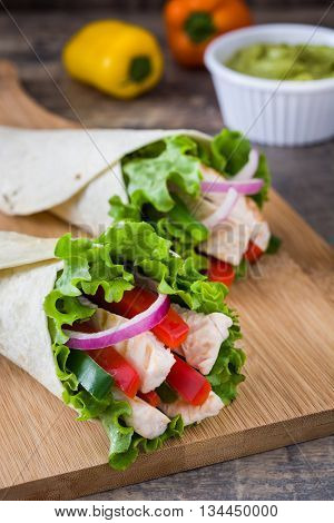 Mexican chicken fajitas on rustic wooden table