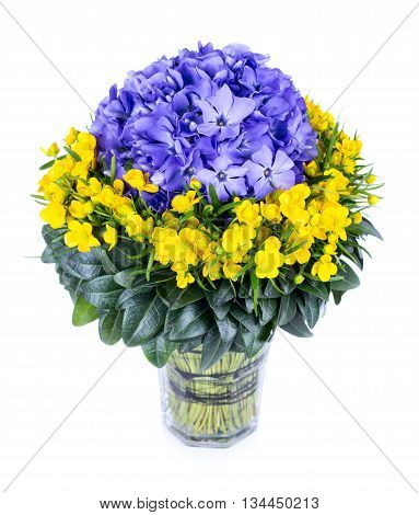Bouquet of periwinkle and buttercup flowers isolated on white background
