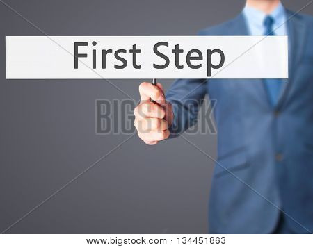 First Step - Businessman Hand Holding Sign