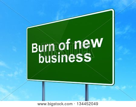 Finance concept: Burn Of new Business on green road highway sign, clear blue sky background, 3D rendering