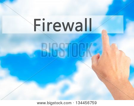 Firewall  - Hand Pressing A Button On Blurred Background Concept On Visual Screen.