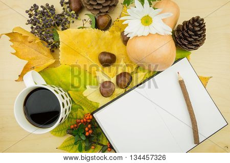 A Bouquet Of Yellow, Green Autumn Leaves With Cup Of Coffee And Blank Notebook With Pencil
