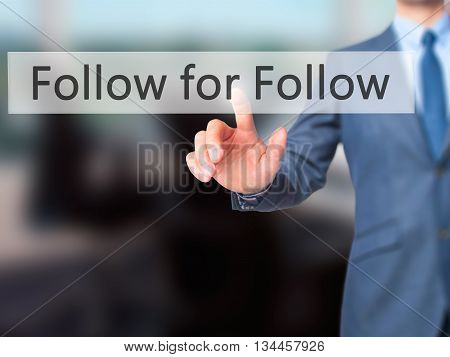 Follow For Follow - Businessman Hand Pressing Button On Touch Screen Interface.