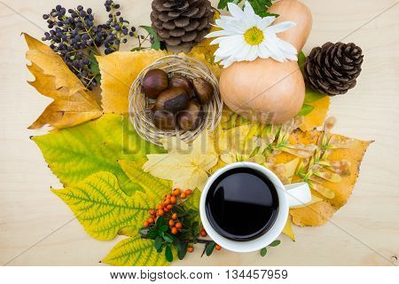 A Bouquet Of Yellow, Green Autumn Leaves With Cup Of Coffee