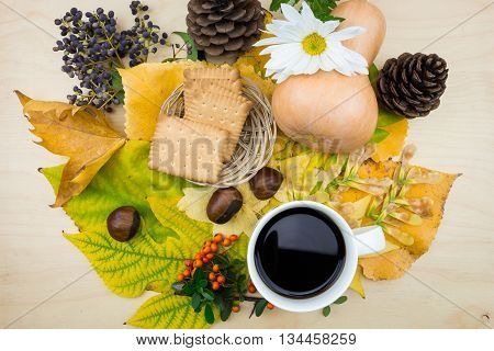 A Bouquet Of Yellow, Green Autumn Leaves With Cup Of Coffee And Cookies