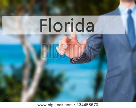 Florida - Businessman Hand Pressing Button On Touch Screen Interface.