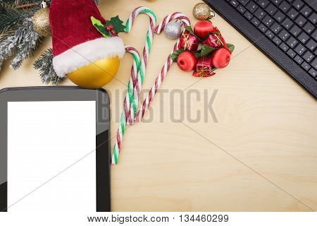 Tablet With Blank Screen  And Winter Festive Ornaments.