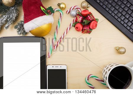 Tablet And Smartphone With Blank Screen, With Cup Of Coffee And Winter Festive Ornaments.