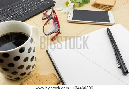 Opened Blank Notebook With Pen, Keyboard  And Cup Of Coffee And Cookies, On Wooden Desktop.