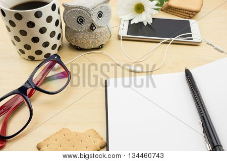 Opened Blank Notebook With Pen, Smartphone And Cup Of Coffee And Cookies, On Wooden Desktop.