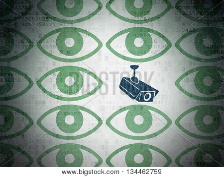 Protection concept: rows of Painted green eye icons around blue cctv camera icon on Digital Data Paper background