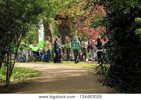 AMSTERDAM, NETHERLANDS - MAY 9, 2013: Group unknown young people have a party in Vondelpark.