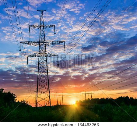 Power lines on a colorful sunrise Electric power lines against sky at sunrise.