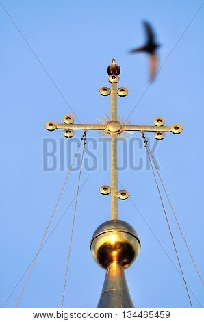 Architecture view - the cross of Saint Sophia Orthodox Cathedral in Veliky Novgorod Russia with a sitting metallic dove symbolizing the Holy Spirit. It is the oldest Orthodox church in Russia.