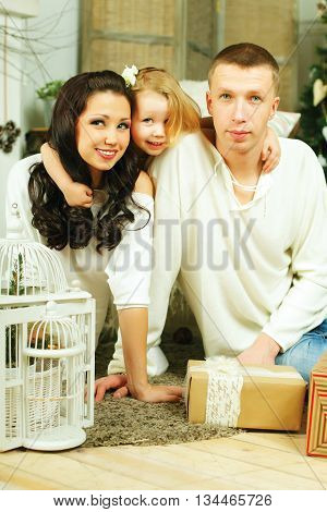 Happy family - child father and mother at Christmas home