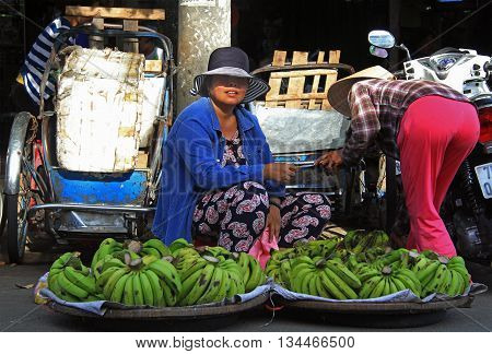 Woman Is Selling Bananas On Street Market In Hue, Vietnam