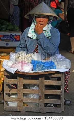 Woman Is Selling Something On Street Market In Hue, Vietnam