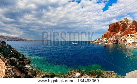 Panorama of Old port Ammoudi of Oia village at Santorini island in Aegean sea, Greece