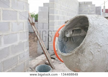 the new orange cement mixer at a construction site