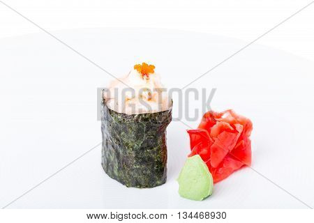 Traditional japanese gunkan sushi with snow crab and tobiko red caviar. Served with ginger and wasabi. Macro. Photo can be used as a whole background.