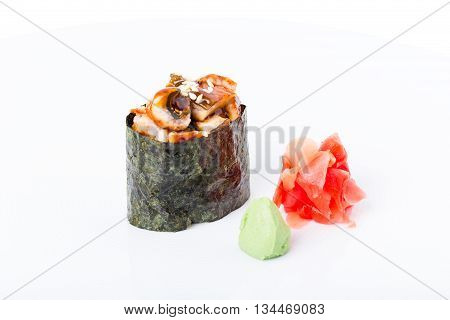 Gunkan sushi stuffed with smoked unagi. Served with ginger and wasabi. Macro. Photo can be used as a whole background.