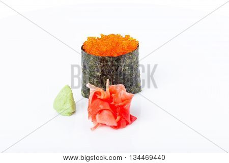 Gunkan sushi stuffed with red tobiko caviar. Served with heap of ginger and wasabi. Macro. Can be used as a whole background.