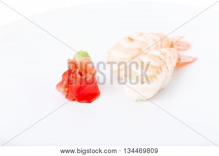 Traditional japanese shrimp nigiri sushi. Served with heap of ginger and wasabi. Macro. Can be used as a whole background.