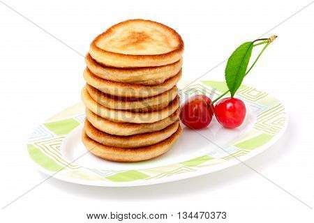 fritters on a plate with cherries isolated on white background.