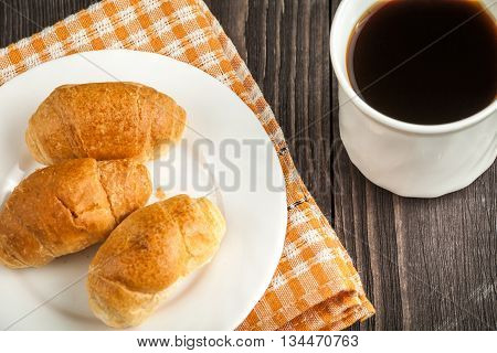 Small Croissants And Cup Of Coffee