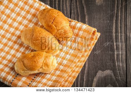 Small Croissant On Wooden Background