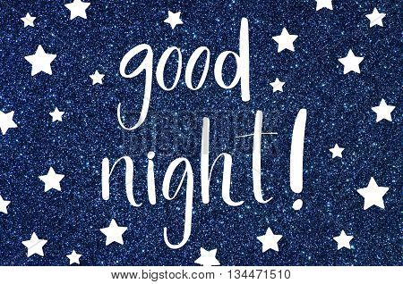 Good night hand lettering text on blue glitter background