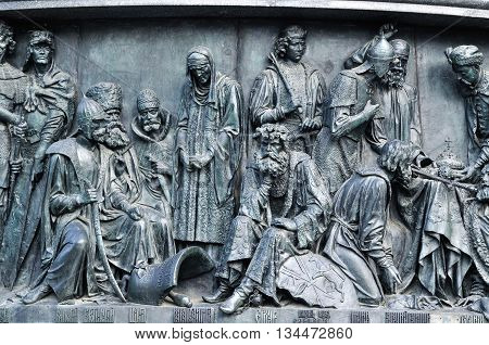 VELIKY NOVGOROD RUSSIA -JUNE 17 2015. Sculptural group Military people and heroes at the monument Millennium of Russia in Veliky Novgorod Russia