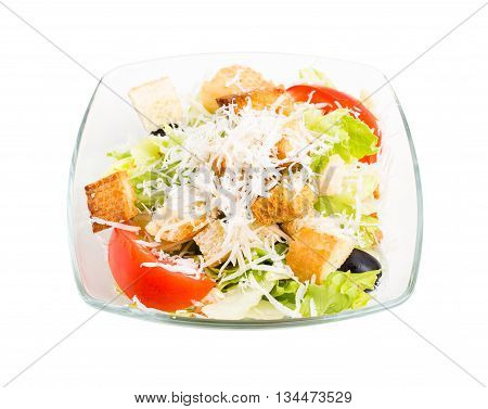 Delicious vegetable salad with croutons and grated cheese. Isolated on a white background.
