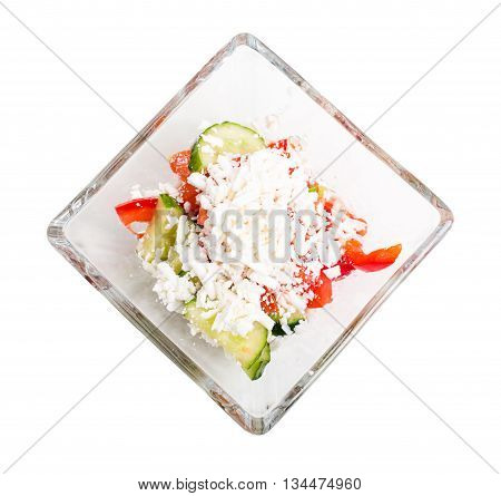 Traditional bulgarian salad shopski with fresh vegetables and grated sheep cheese. Isolated on a white background.