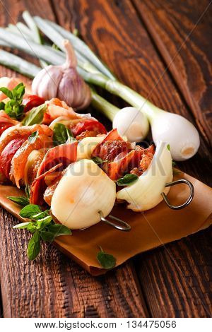 Two Skewers With Vegetable And Various Meat On Wooden Board