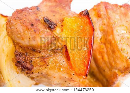 Grilled pork shish kebab with paprika and onions. Macro. Photo can be used as a whole background.