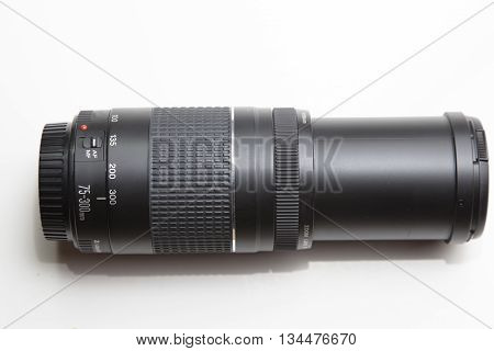Zoom lens for digital SLR camera. isolated lens on a white background. 75 300 mm lens