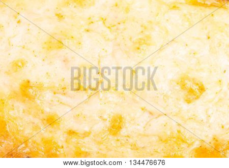Closeup of melted cheese. Macro. Photo can be used as a whole background.