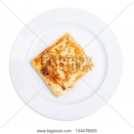 Pancake stuffed with ham and cheese. Isolated on a white background.