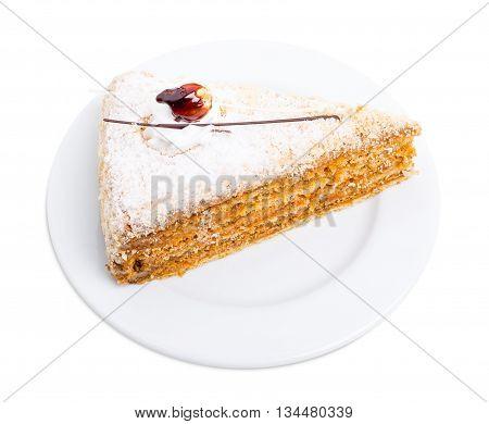 Delicious cake with crunchy sugar and cream. Isolated on a white background.