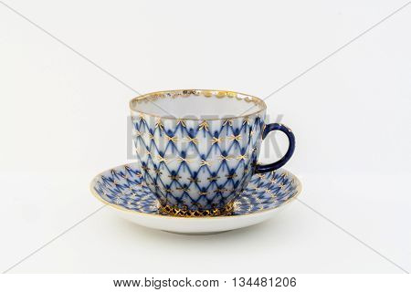 Coffee cup and saucer production of the Imperial (Lomonosov) Porcelain Factory. Branded cobalt mesh with gold ornament.