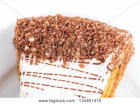 Delicious cake with grated chocolate and walnuts. Macro. Photo can be used as a whole background.