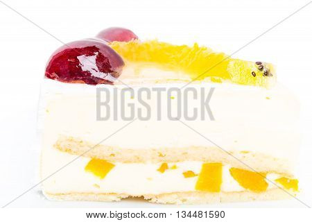Creamy yougurt mousse cake with fruits on top. Macro. Photo can be used as a whole background.