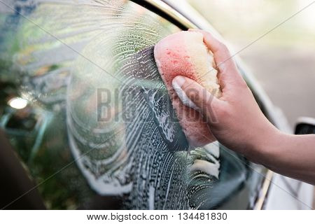 Handle Car Wash Concept - Male Hand Holding Sponge And Washing Car Window
