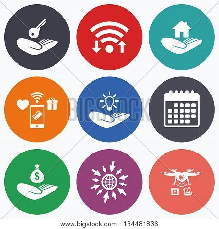 Wifi, mobile payments and drones icons. Helping hands icons. Financial money savings insurance symbol. Home house or real estate and lamp, key signs. Calendar symbol.