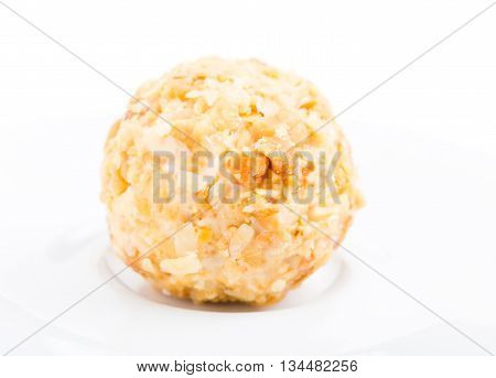 White chocolate candy with crumbled biscuit. Macro. Photo can be used as a whole background.