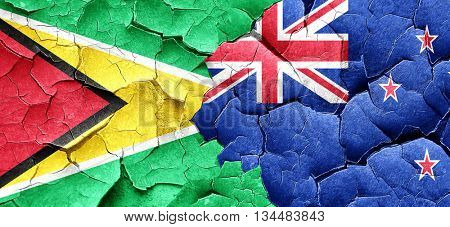 Guyana flag with New Zealand flag on a grunge cracked wall