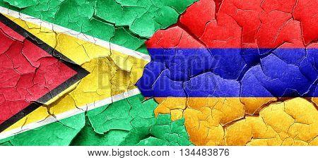 Guyana flag with Armenia flag on a grunge cracked wall