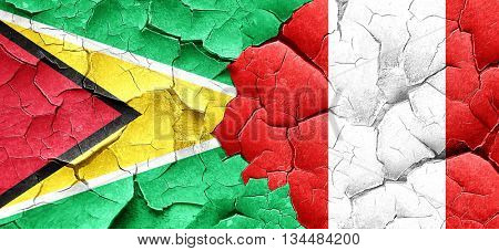 Guyana flag with Peru flag on a grunge cracked wall